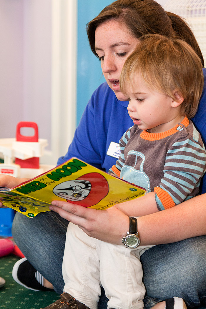 Culham Nursery key working helping a toddler to read